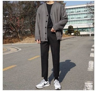 Black Crew-neck T-shirt Outfits For Men: This combination of a black crew-neck t-shirt and black chinos is an appealing option for off duty. A nice pair of grey athletic shoes is the most effective way to inject a dash of stylish casualness into your getup.