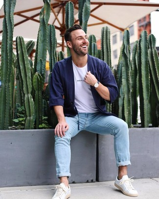How to wear: navy cardigan, white crew-neck t-shirt, light blue jeans, white leather low top sneakers