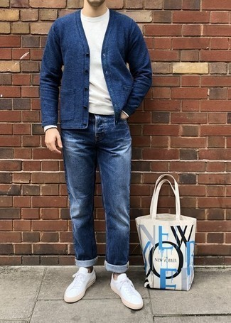 How To Wear Blue Jeans With a Blue Sweater For Men: For an outfit that provides functionality and fashion, opt for a blue sweater and blue jeans. To introduce a little fanciness to your outfit, rock a pair of white canvas low top sneakers.