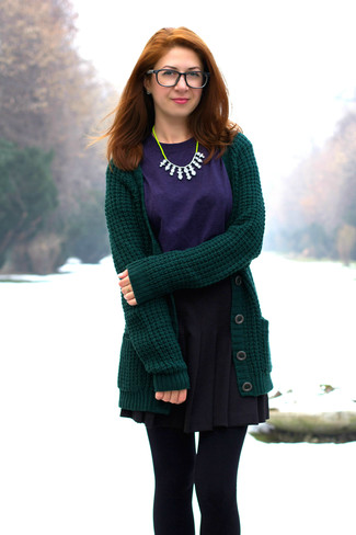 How to wear: dark green knit cardigan, violet crew-neck t-shirt, black skater skirt, green-yellow necklace
