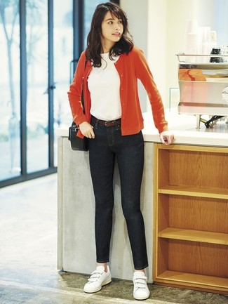 How to wear: red cardigan, white crew-neck t-shirt, black skinny jeans, white leather low top sneakers
