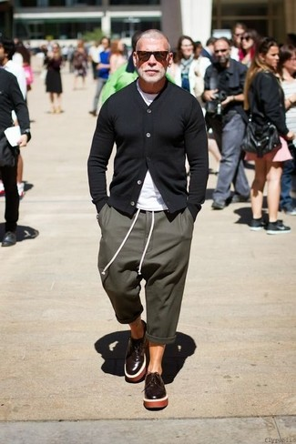 Nick Wooster wearing Black Cardigan, White Crew-neck T-shirt, Olive Sweatpants, Dark Brown Leather Derby Shoes