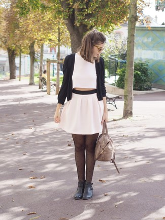 How to wear: black cardigan, white cropped top, white pleated mini skirt, black leather ankle boots
