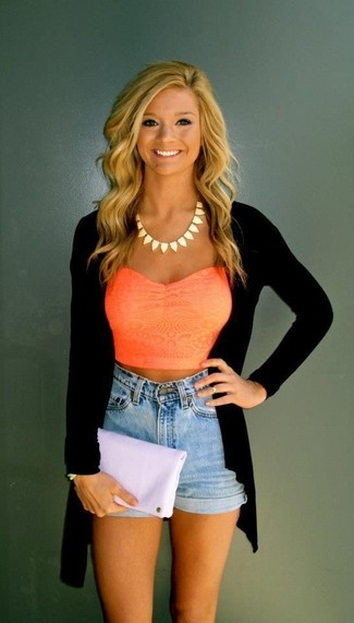 A nicely put together combination of an orange cropped top and light blue denim shorts will set you apart effortlessly.