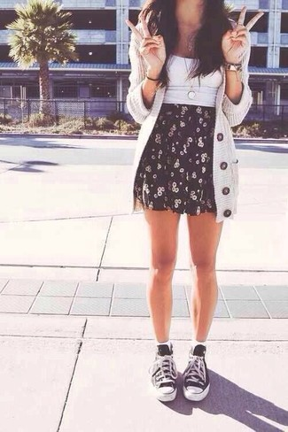 A white cropped top and a black and white graphic skater skirt is a savvy combination to carry you throughout the day. Black and white low top sneakers will add some edge to an otherwise classic look.