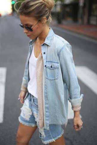 Stand out among other stylish civilians in a cream cardigan and light blue ripped denim shorts.