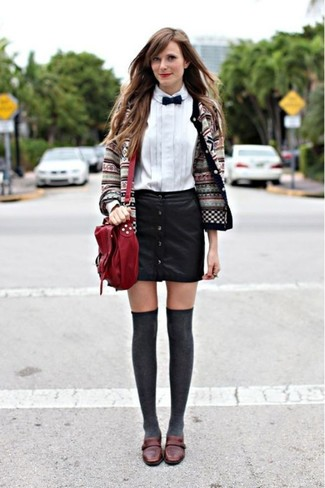 How to wear: grey fair isle cardigan, white dress shirt, black leather button skirt, dark brown leather loafers