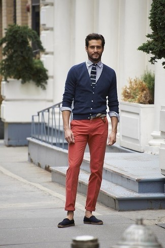 Consider wearing a navy cardigan and red casual trousers for a casual level of dress. Complement this look with dark blue canvas espadrilles.