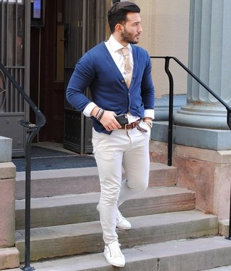 How to wear: navy cardigan, white dress shirt, white chinos, white leather low top sneakers