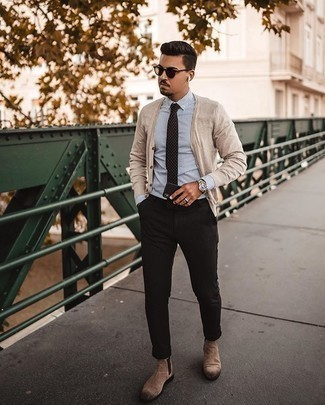 White and Blue Vertical Striped Dress Shirt Outfits For Men: This combination of a white and blue vertical striped dress shirt and black chinos is a must-try casually smart look for any modern gentleman. If you feel like stepping it up, add tan suede chelsea boots to this outfit.