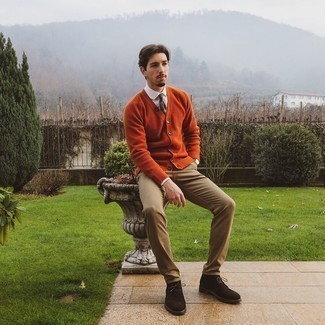 Khaki Chinos Outfits: Choose an orange cardigan and khaki chinos for standout menswear style. Complement this outfit with a pair of dark brown suede desert boots and ta-da: the outfit is complete.