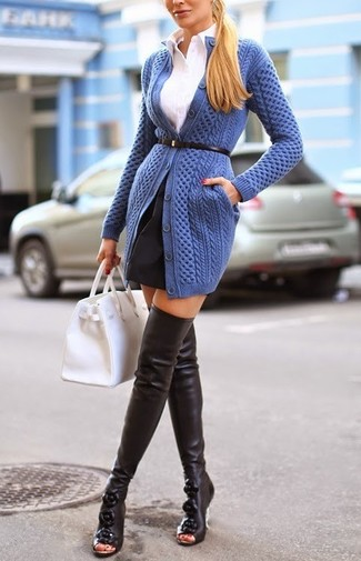 To create an outfit for lunch with friends at the weekend team a blue knit cardigan with a black full skirt. Finish off your look with black leather thigh high boots.
