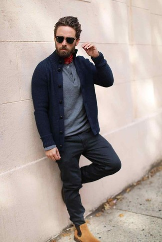 How to wear: navy cardigan, grey henley sweater, black jeans, tan suede chelsea boots