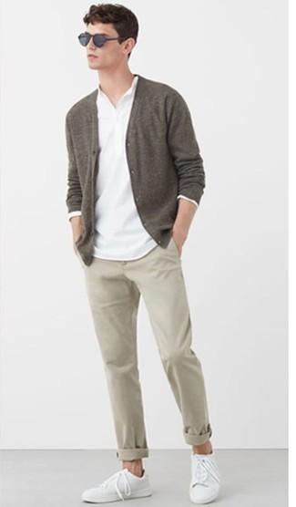 White Long Sleeve Henley Shirt Outfits For Men: This combination of a white long sleeve henley shirt and beige chinos is the perfect foundation for a myriad of getups. Complete your ensemble with a pair of white canvas low top sneakers and you're all set looking spectacular.