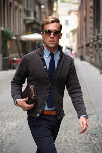 The versatility of a charcoal cardigan and navy blue chinos makes them investment-worthy pieces.