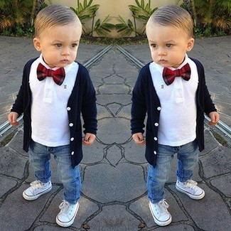 How to Wear a Navy Cardigan For Boys: Suggest that your little angel wear a navy cardigan with blue jeans for a dapper casual get-up. As far as footwear is concerned, suggest that your child opt for a pair of white sneakers.