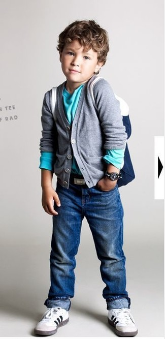 How to Wear a Grey Cardigan For Boys: This combo of a grey cardigan and blue jeans is both a comfortable and stylish choice for your darling. This look is complemented brilliantly with white sneakers.