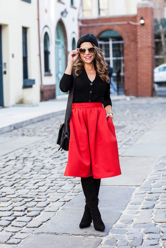 Red Pleated Midi Skirt Outfits: If you love laid-back pairings, then you'll love this combination of a black cardigan and a red pleated midi skirt. Our favorite of a countless number of ways to complete this outfit is with black suede over the knee boots.
