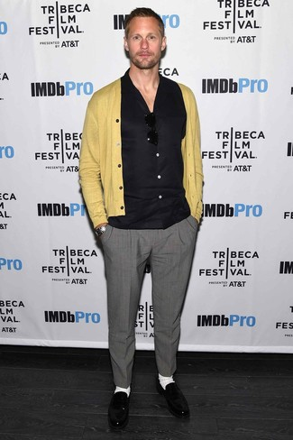 Alexander Skarsgård wearing Mustard Cardigan, Black Short Sleeve Shirt, Grey Dress Pants, Black Leather Loafers