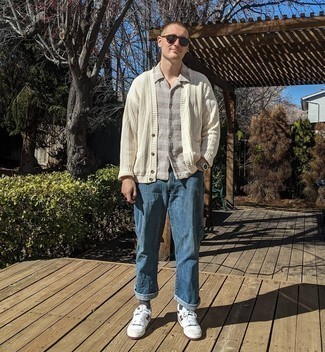Cardigan Outfits For Men: Effortlessly blurring the line between cool and laid-back, this combo of a cardigan and blue jeans will likely become your favorite. Unimpressed with this outfit? Let white and red leather low top sneakers jazz things up.