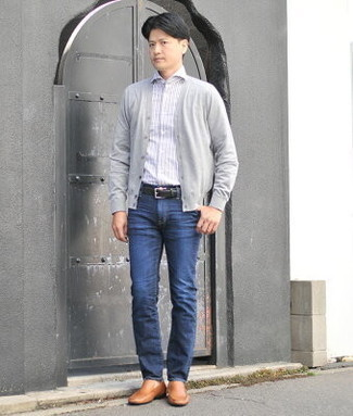 Men's Outfits 2021: This combo of a grey cardigan and navy jeans is a safe and very stylish bet. To bring a little zing to this look, introduce a pair of tobacco leather loafers to the mix.