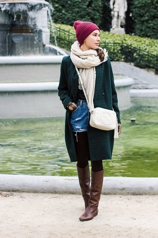 How to wear: dark green knit cardigan, blue denim shorts, dark brown leather knee high boots, white leather crossbody bag