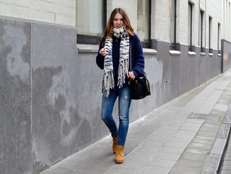 A nicely put together combination of a navy knit cardigan and blue ripped slim jeans will set you apart effortlessly. Tan suede lace-up boots will give your look an on-trend feel.