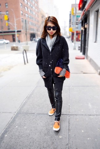How to wear: black chunky cardigan, black leather skinny pants, orange slip-on sneakers, navy fur clutch