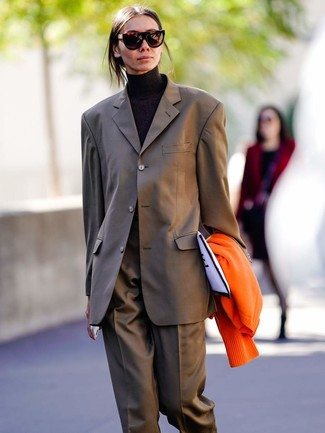 How to wear: orange cardigan, brown suit, black turtleneck, white and black print canvas clutch