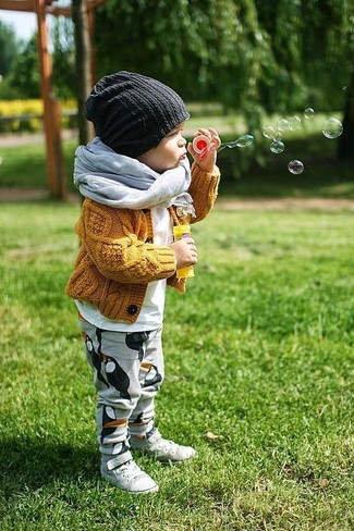 How to Wear a Grey Scarf For Boys: Go for a mustard cardigan and a grey scarf for your little angel for a fun day in the park. As far as footwear is concerned, suggest that your boy throw in a pair of grey sneakers.