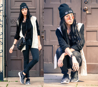 How to wear: white and black knit cardigan, black chiffon tank, black jeans, charcoal athletic shoes