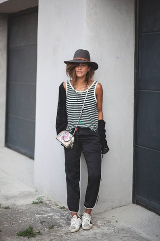 This combination of a black cardigan and a hat will add a graceful essence to your look. Want to go easy on the shoe front? Make white leather low top sneakers your footwear choice for the day. And if you're looking for a stylish winter-to-spring transition outfit, this one is great.