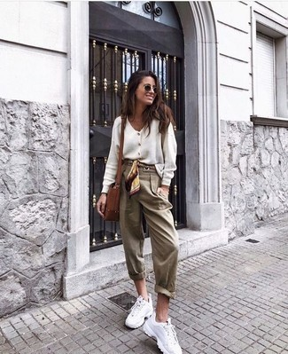 How to wear: white cardigan, tan tapered pants, white athletic shoes, brown leather crossbody bag
