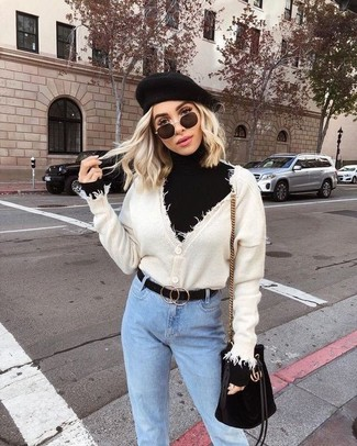 How to wear: beige cardigan, black turtleneck, light blue jeans, black suede bucket bag