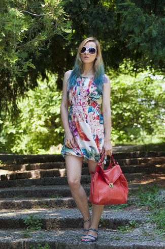 How to wear: multi colored print casual dress, blue leather flat sandals, red leather satchel bag, white sunglasses