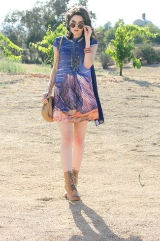 How to wear: blue print casual dress, tan leather lace-up ankle boots, tan leather crossbody bag, orange bracelet