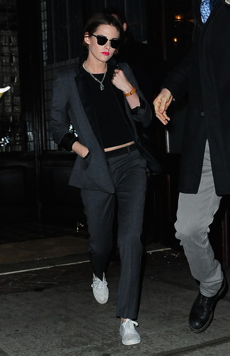 Kristen Stewart wearing Charcoal Blazer, Black Crew-neck Sweater, Charcoal Dress Pants, White Canvas Low Top Sneakers