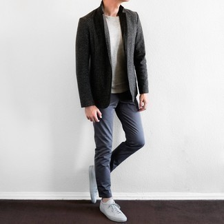 White Leather Low Top Sneakers Outfits For Men: This pairing of a charcoal blazer and navy chinos might pack a punch, but it's very easy to imitate too. To introduce a dressed-down touch to this ensemble, add white leather low top sneakers to this ensemble.
