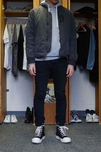 Men's Looks & Outfits: What To Wear In Fall: To assemble a casual getup with a contemporary spin, you can go for a charcoal bomber jacket and black chinos. Black and white canvas high top sneakers will give a carefree touch to an otherwise traditional look. We're loving how great this one is for in-between weather.