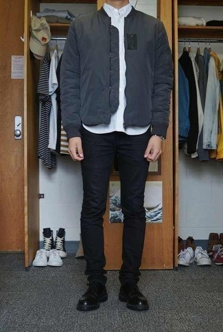 Men's Looks & Outfits: What To Wear In 2020: This combo of a charcoal bomber jacket and black skinny jeans is on the casual side but is also sharp and incredibly sharp. Black leather derby shoes will put an elegant spin on this outfit.