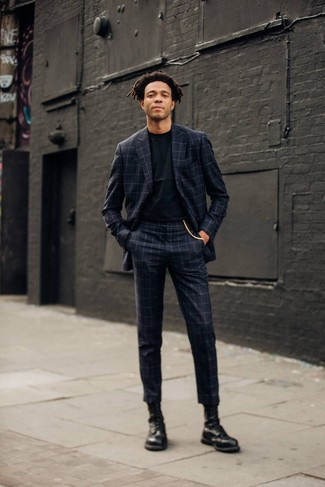 How to Wear a Black Crew-neck T-shirt For Men: Show that nobody does smart men's style quite like you do in a black crew-neck t-shirt and a charcoal check suit. If in doubt about what to wear when it comes to shoes, go with black leather casual boots.