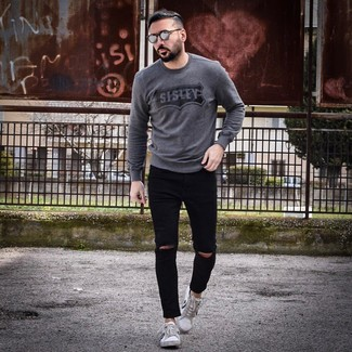How to wear: charcoal print crew-neck sweater, black ripped skinny jeans, white and black low top sneakers, grey sunglasses