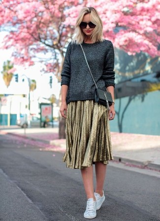 Opt for a charcoal crew-neck sweater and a gold pleated midi skirt for a glam and trendy getup. A pair of Converse Limited Edition White Monochrome Chuck Taylor All Star Lo Canvas Sneaker will be a stylish addition to your getup. This one will play especially well when warmer days are here.