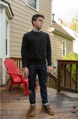 How to wear: charcoal crew-neck sweater, grey long sleeve shirt, navy jeans, brown leather desert boots