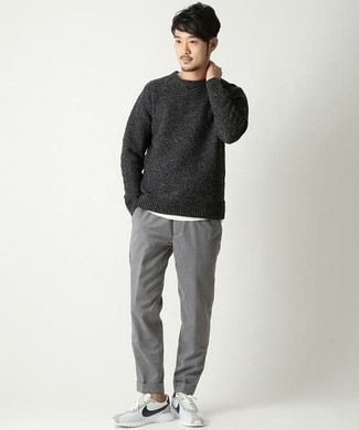 How to Wear a Charcoal Crew-neck Sweater For Men: We're loving how well a charcoal crew-neck sweater partners with grey chinos. And if you want to easily play down this look with one single item, why not complete your ensemble with white and black athletic shoes?