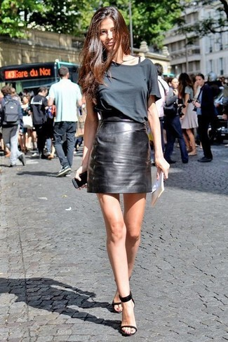 How to wear: charcoal crew-neck t-shirt, black leather mini skirt, black leather heeled sandals