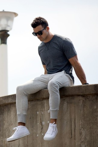 How to wear: charcoal crew-neck t-shirt, grey sweatpants, white leather high top sneakers, black sunglasses