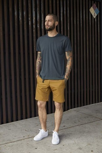 How to Wear White Canvas Low Top Sneakers For Men: A charcoal crew-neck t-shirt and mustard shorts are the perfect way to inject extra cool into your daily outfit choices. If you're on the fence about how to finish, add a pair of white canvas low top sneakers to the mix.
