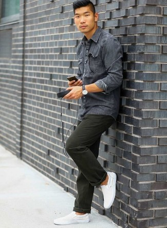 How to Wear White Canvas Slip-on Sneakers For Men: For a laid-back ensemble, make a charcoal denim shirt and dark green chinos your outfit choice — these pieces fit perfectly well together. White canvas slip-on sneakers are the glue that pulls this look together.