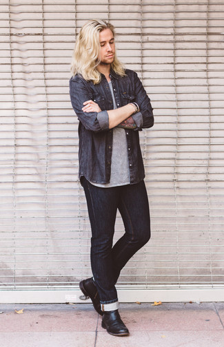 How to Wear a Charcoal Denim Shirt For Men: A charcoal denim shirt and black jeans are veritable menswear must-haves if you're putting together an off-duty wardrobe that holds to the highest sartorial standards. Black leather chelsea boots will class up any outfit.
